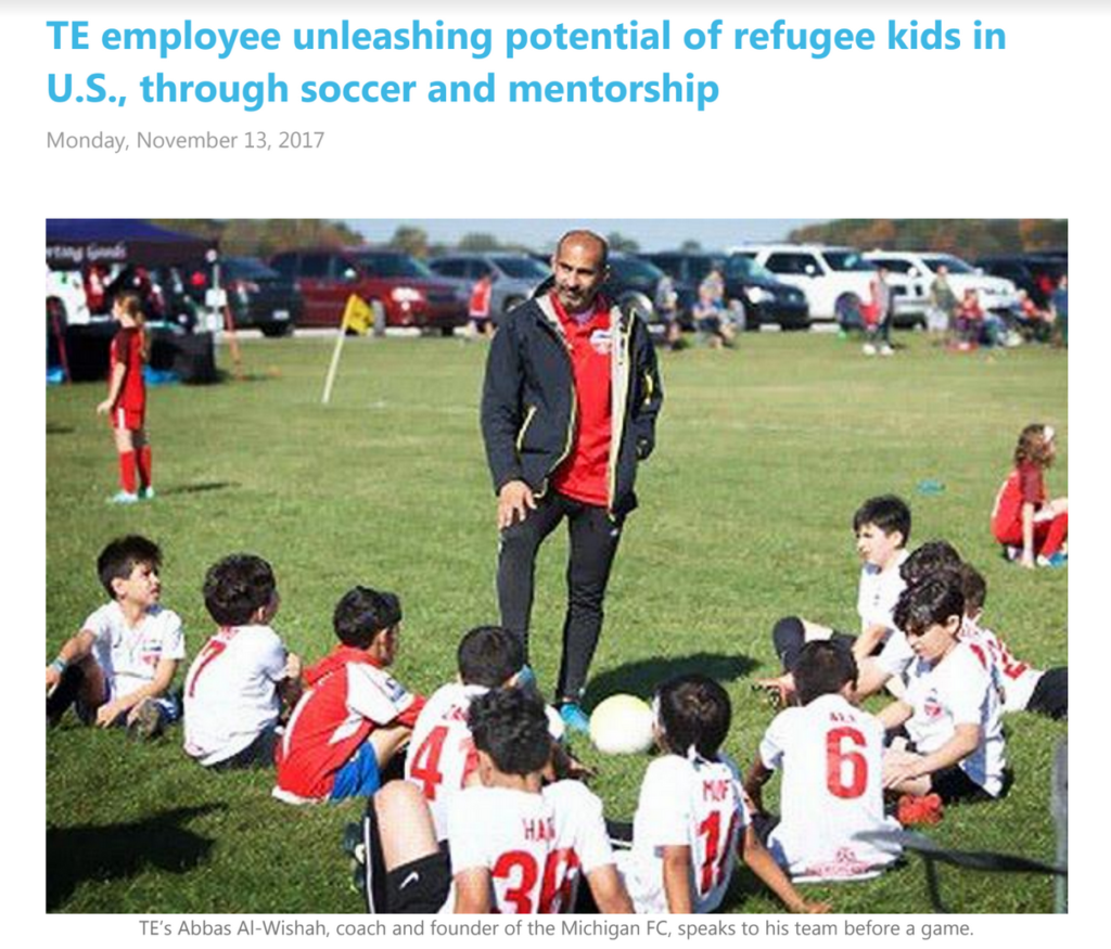 Employee coaches refugee kids
